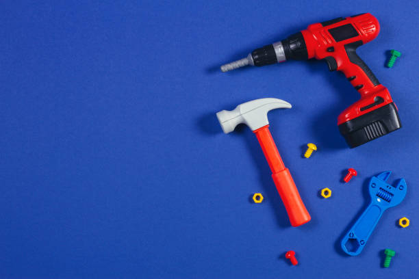 Toys background. Top view of toy tools on blue background Toys background. Top view of toy tools on blue background. socket wrench stock pictures, royalty-free photos & images