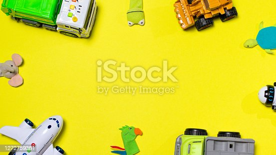 Children's toys on a yellow background with space for text banner. Copyspace. For the toy and children's goods store.
