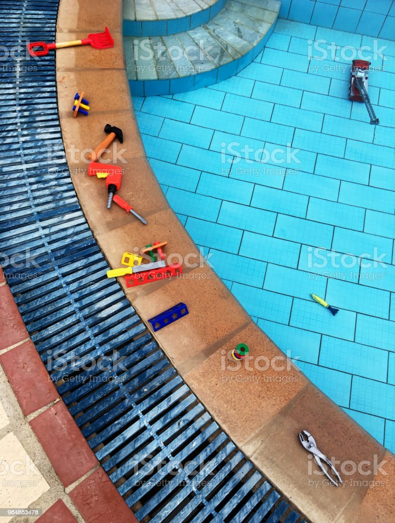 Toys on the Edge of a Swimming Pool royalty-free stock photo