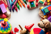 Toys on white sheet of paper with centered copy space for design.