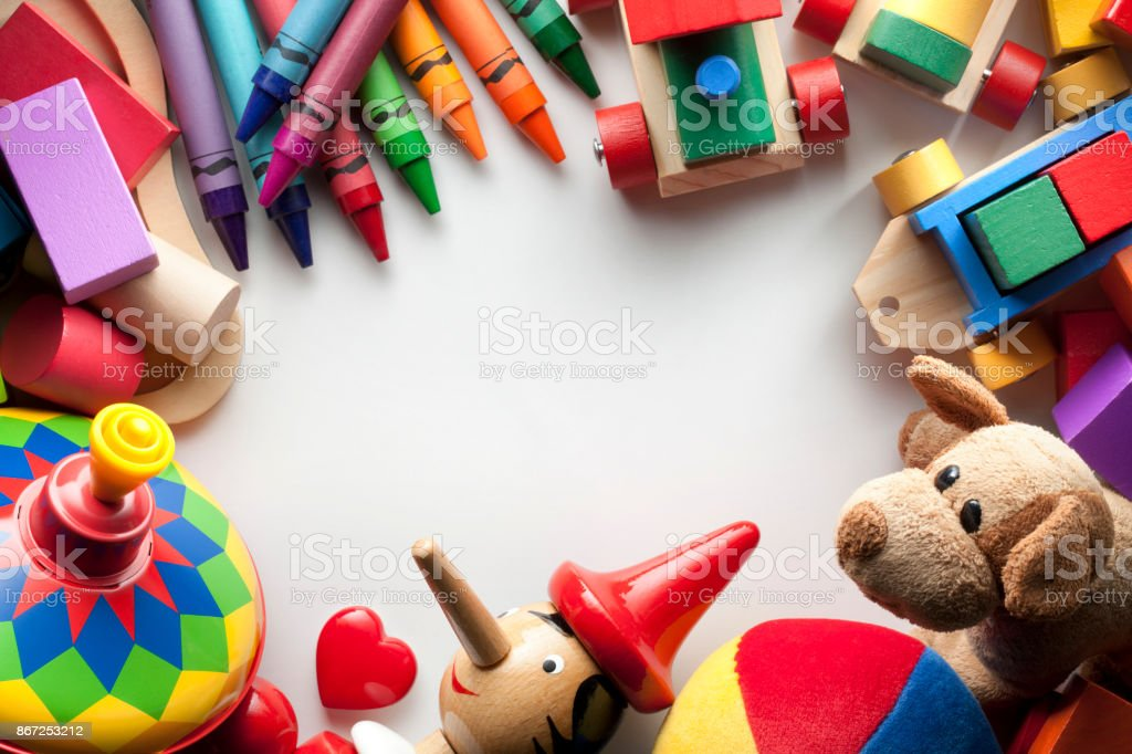 Toys on white sheet of paper with centered copy space for design stock photo