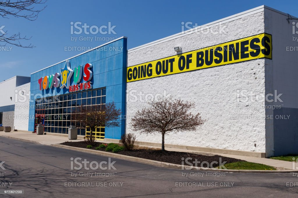 Toys 'R' Us Retail Strip Mall Location. Toys 'R' Us is going out of business after filing bankruptcy I stock photo