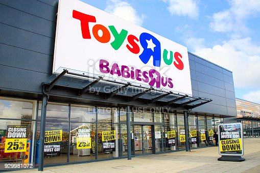 Swansea, UK: March 08, 2018: Front view of a Toys R Us store with closing down signs in the window. Toys R Us Inc. is an American toy retailer headquartered in New Jersey, USA.