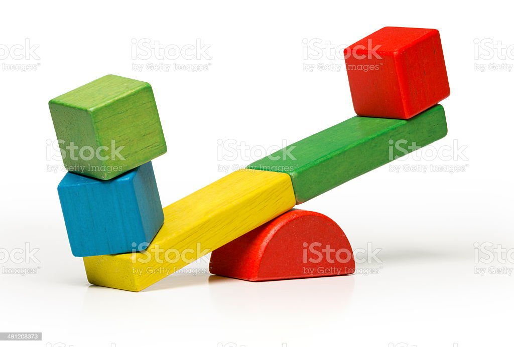 toys seesaw wooden blocks, teeter totter isolated on white background stock photo