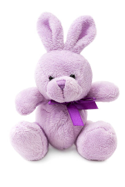 Toys: small pink or lilac rabbit, isolated on white background stock photo
