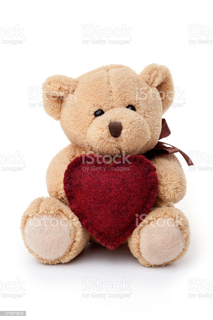 Toys: teddy bear holding red heart stock photo