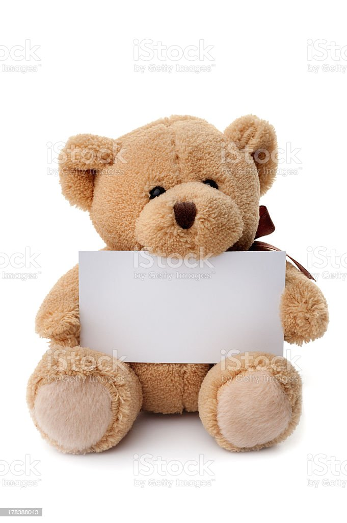Toys: teddy bear holding white banner stock photo