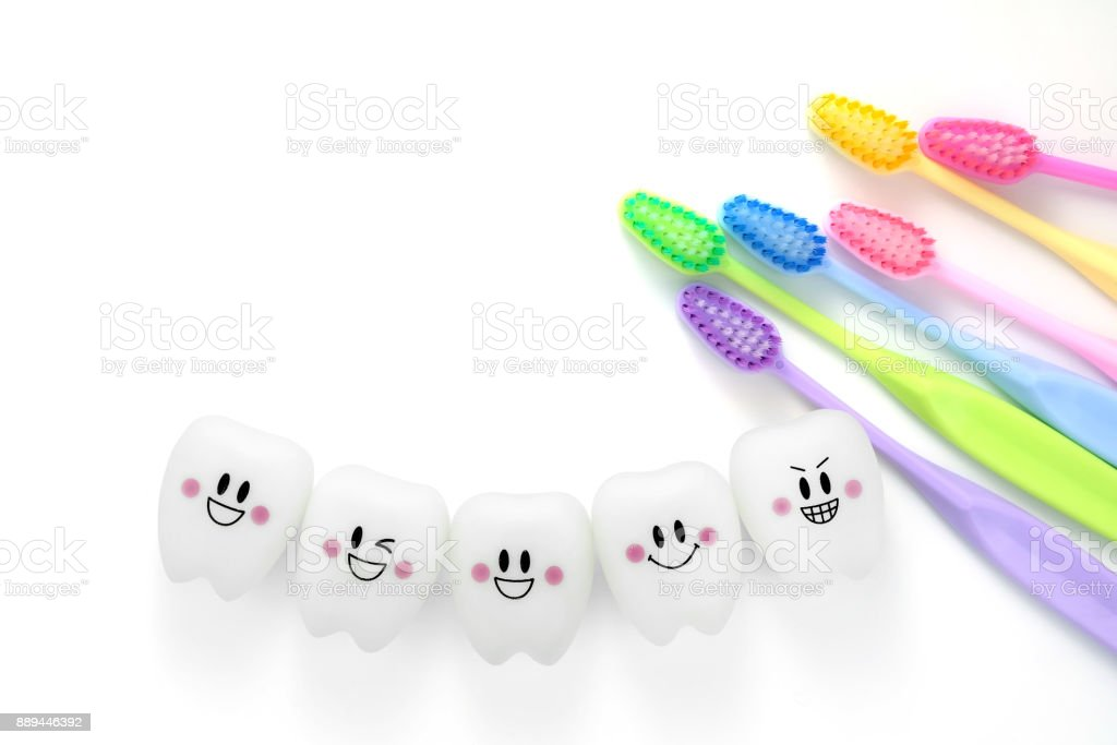 Toys teeth dental in a smiling mood with tooth brush colorful stock photo
