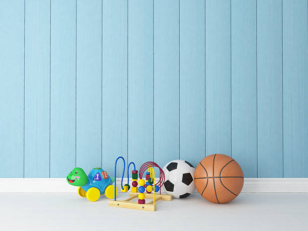 spielzeug aus holz hintergrund mit blau - fußball themenzimmer stock-fotos und bilder