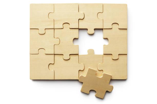 Toys: Wooden Jigzaw Puzzle Isolated on White Background stock photo