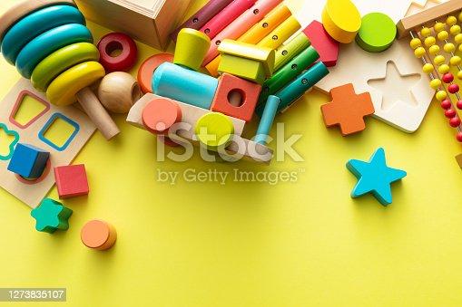 istock Toys: Wooden Toys on Yellow Background Still Life 1273835107