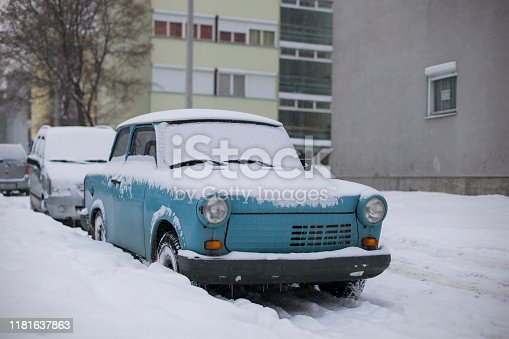 Trabant iconic car of eastern Europe on street in winter