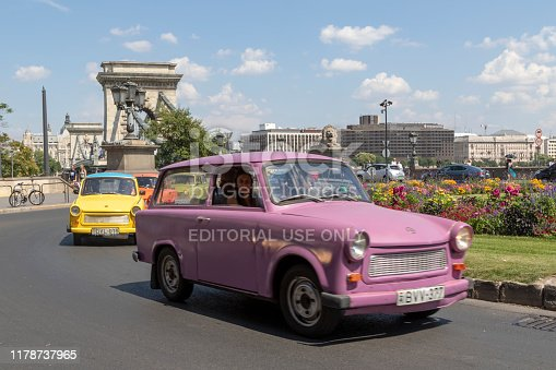 Budapest, Hungary - Jun 17, 2018: Old East German car - the Trabant is still a tourist attractions on the street of Budapest.  These popular and cheap communist vehicles was an East Germany and the former eastern bloc icon.