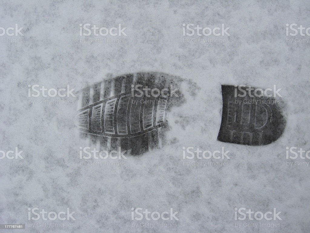 Trace of shoe on a snow royalty-free stock photo