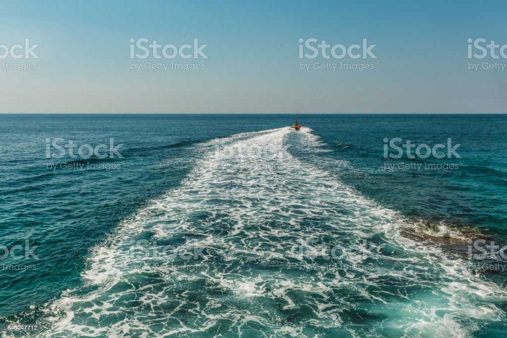 A trace on the surface of the Adriatic Sea behind a speed boat near the city of Budva, Montenegro. stock photo