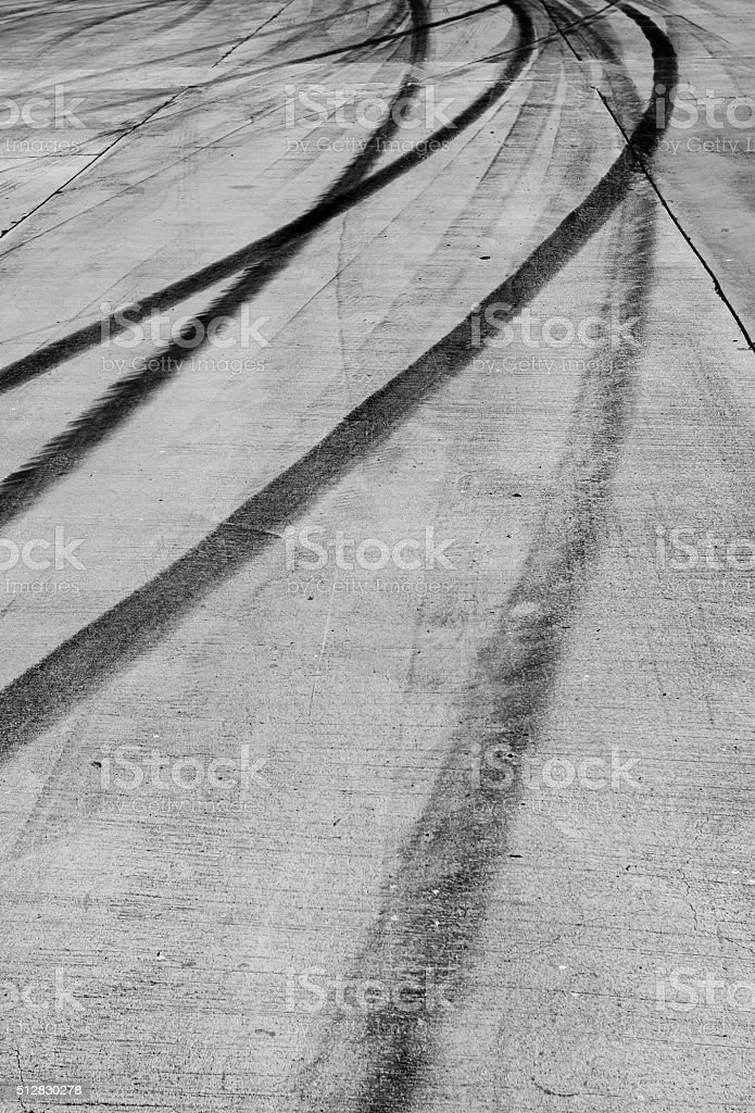 Traces of a braking on asphalt stock photo