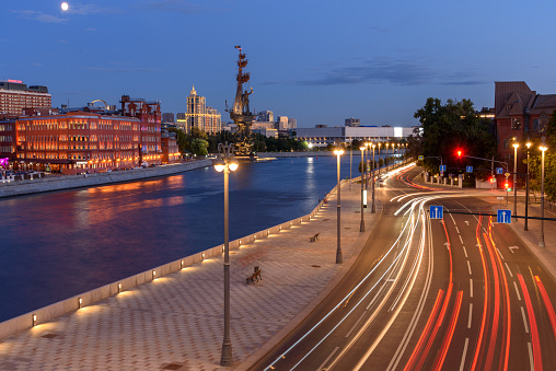Traces of car headlights moving cars. Evening view of the embankment of the Moscow River.
