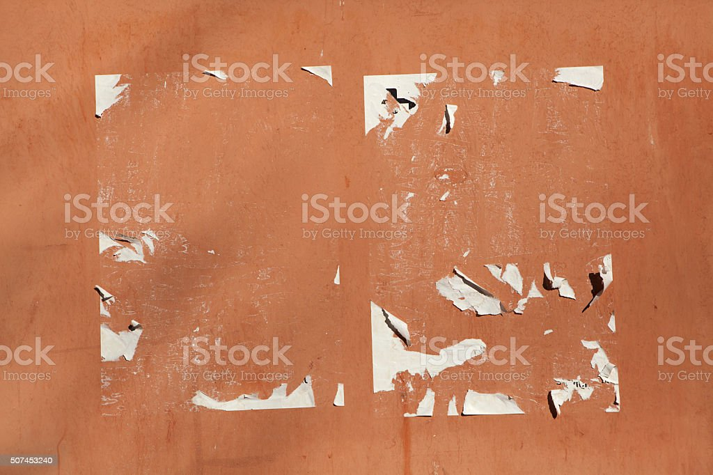 Traces of old announcements on terracotta wall. Background textu stock photo