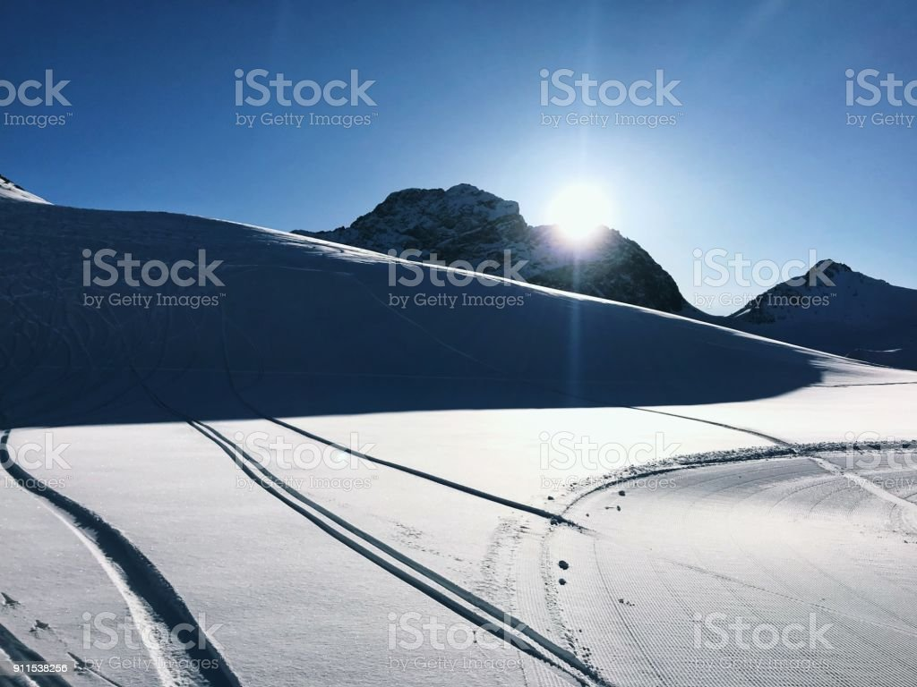 Traces of ski in the snow stock photo
