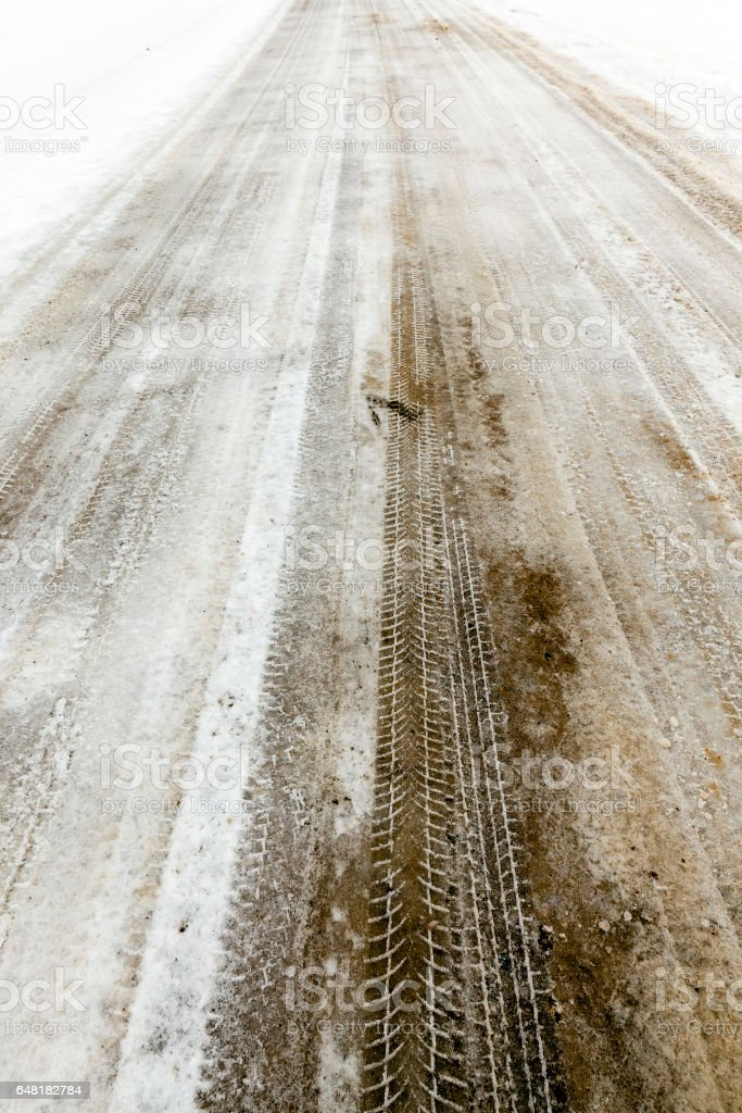 traces of the car on snow stock photo