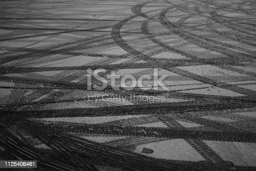 traces of tires on the snow in the night