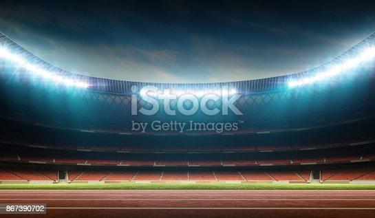 illuminated night soccer stadium with running track, 3D stadium, digitally generated image