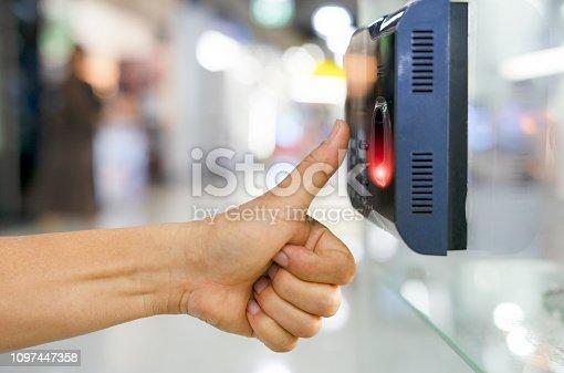 1058987638 istock photo Track Employee Hours Using Biometric Fingerprint Scanner. 1097447358