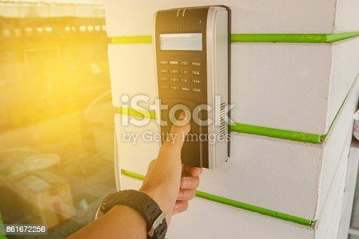 1058987638 istock photo Track Employee Hours Using Biometric Fingerprint Scanner. 861672256