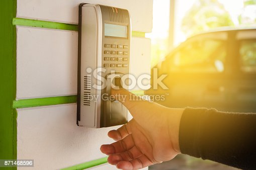 1058987638 istock photo Track Employee Hours Using Biometric Fingerprint Scanner. 871468596