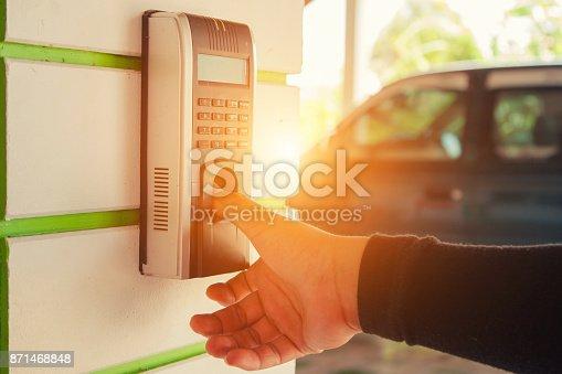 1058987638 istock photo Track Employee Hours Using Biometric Fingerprint Scanner. 871468848