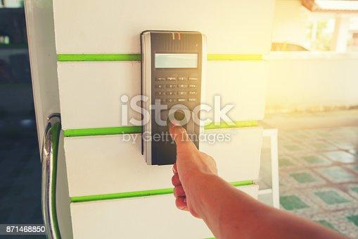 1058987638 istock photo Track Employee Hours Using Biometric Fingerprint Scanner. 871468850