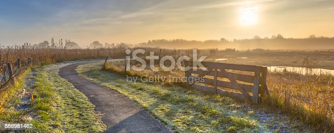 istock Track in misty agricultural landscape 886981462