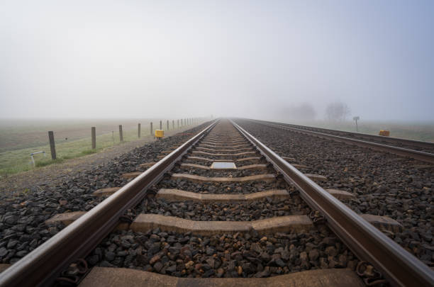Track in the fog stock photo