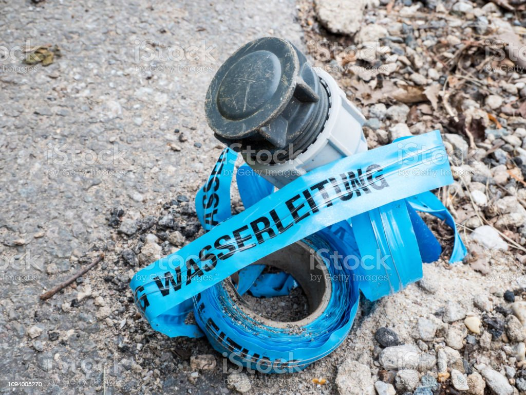Track warning tape water pipe with water pipe stock photo