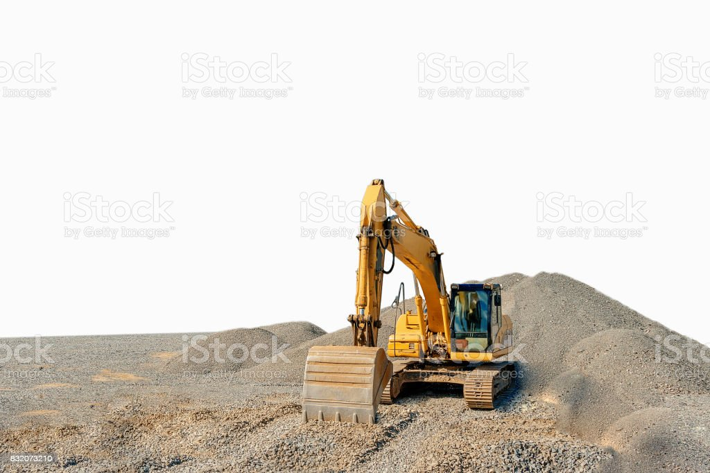 Tracked excavator on a construction site among piles of rubble isolated stock photo