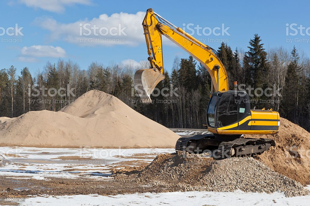 Tracked excavator on a construction site stock photo