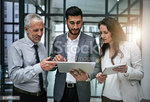 603310486istockphoto Tracking business concerns as a team 629359372
