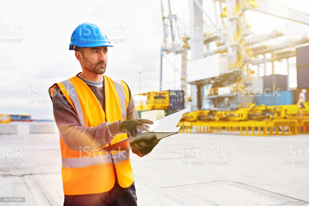 Tracking shipments on the dock stock photo