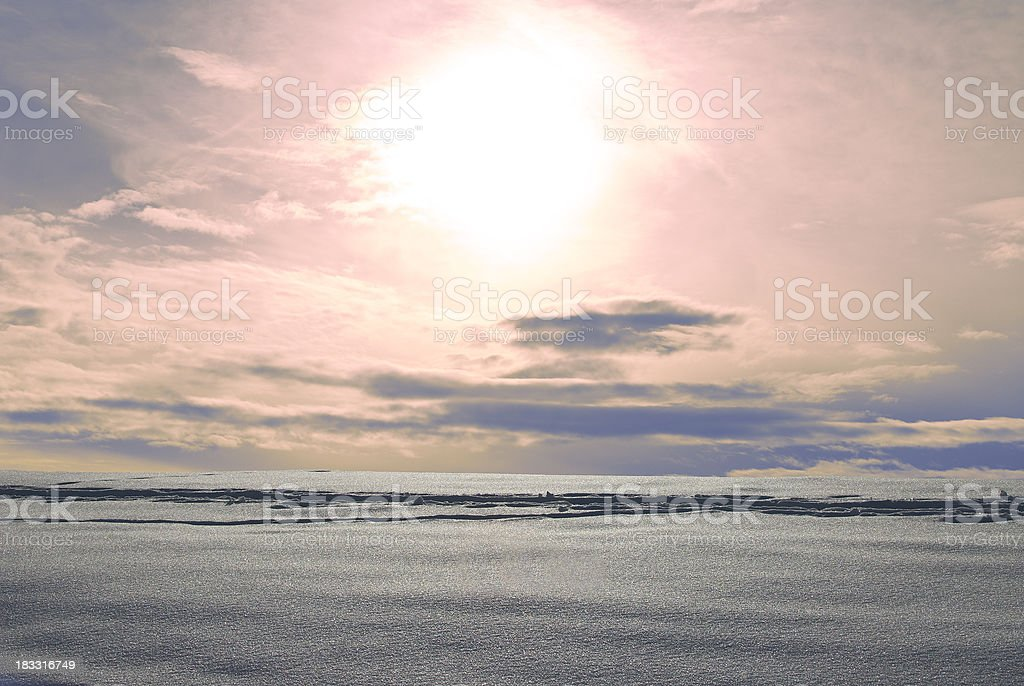 Tracks in snow against the light and pink sky royalty-free stock photo