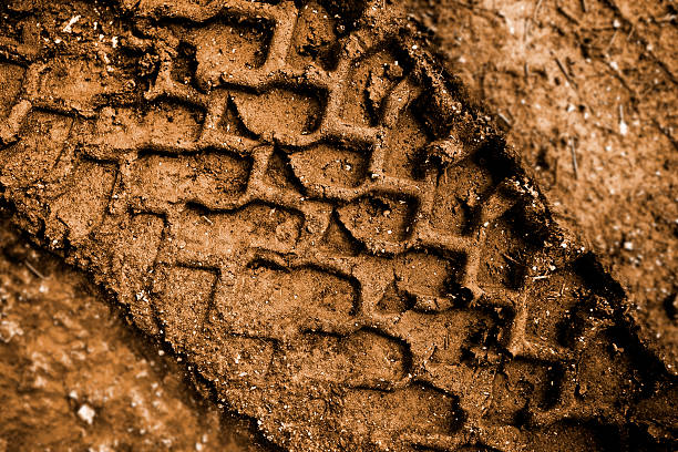 Tracks in the mud  tire track stock pictures, royalty-free photos & images