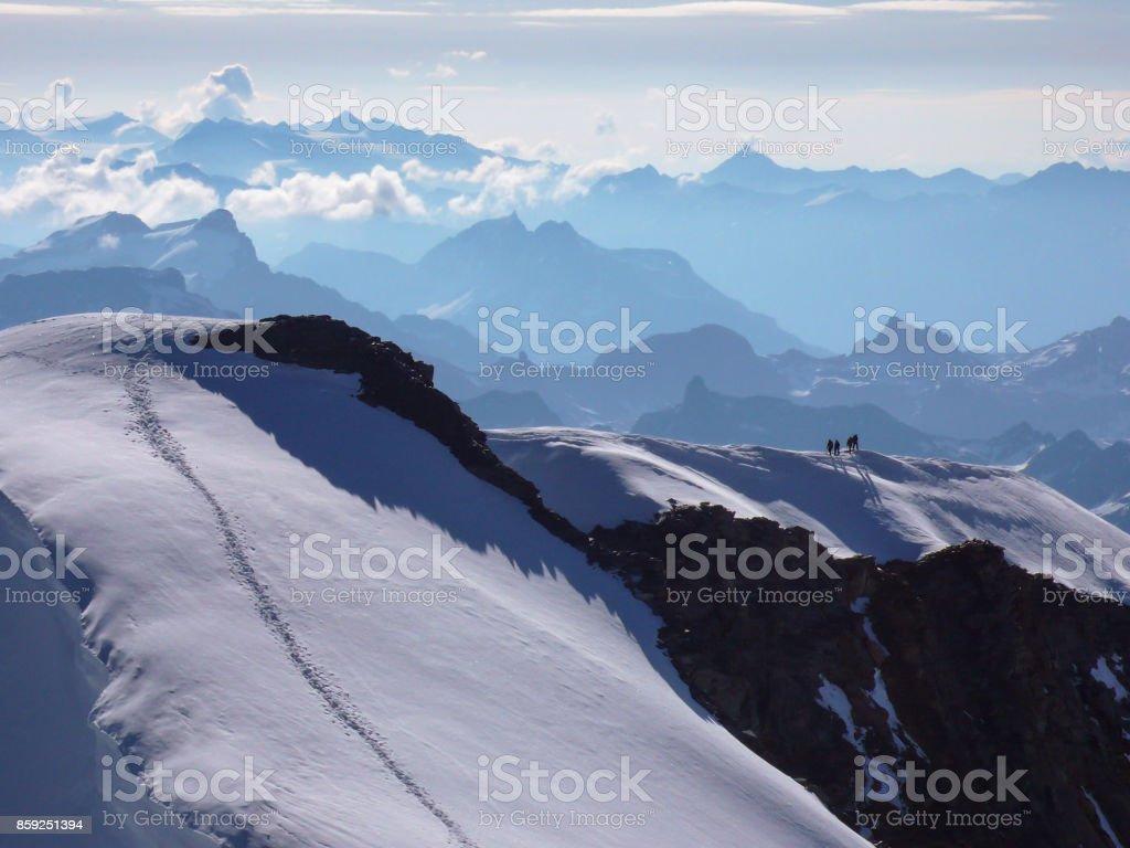 tracks leading to summit of Piz Palu in the Swiss Alps near St. Moritz stock photo