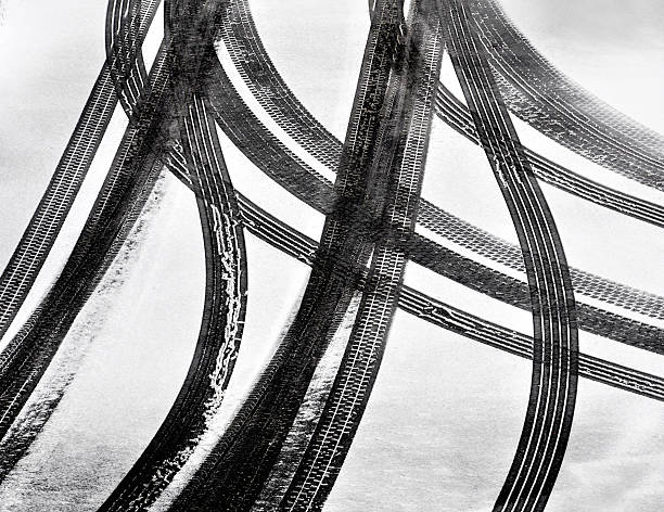 Tracks of car tires Tracks of car tires in thin layer of first snow tire track stock pictures, royalty-free photos & images