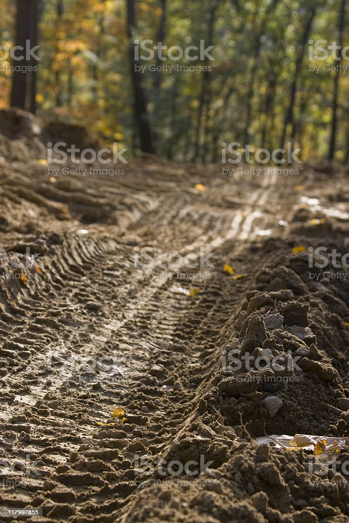 Tracks on a dirt road in Autumn royalty-free stock photo
