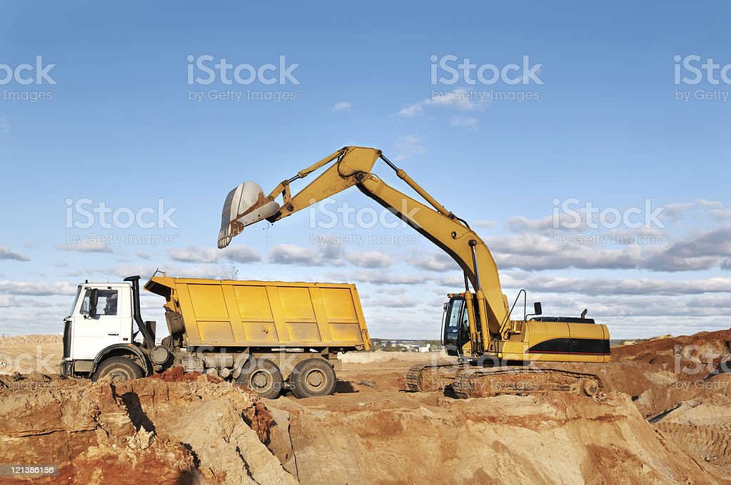 track-type loader excavator and tipper dumper royalty-free stock photo