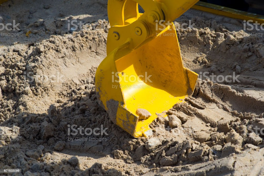 track-type loader excavator machine doing earthmoving work at sand quarry stock photo