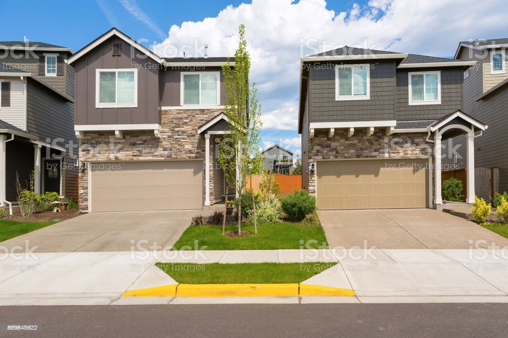 Tract homes front in new subdivision in North America suburb USA stock photo