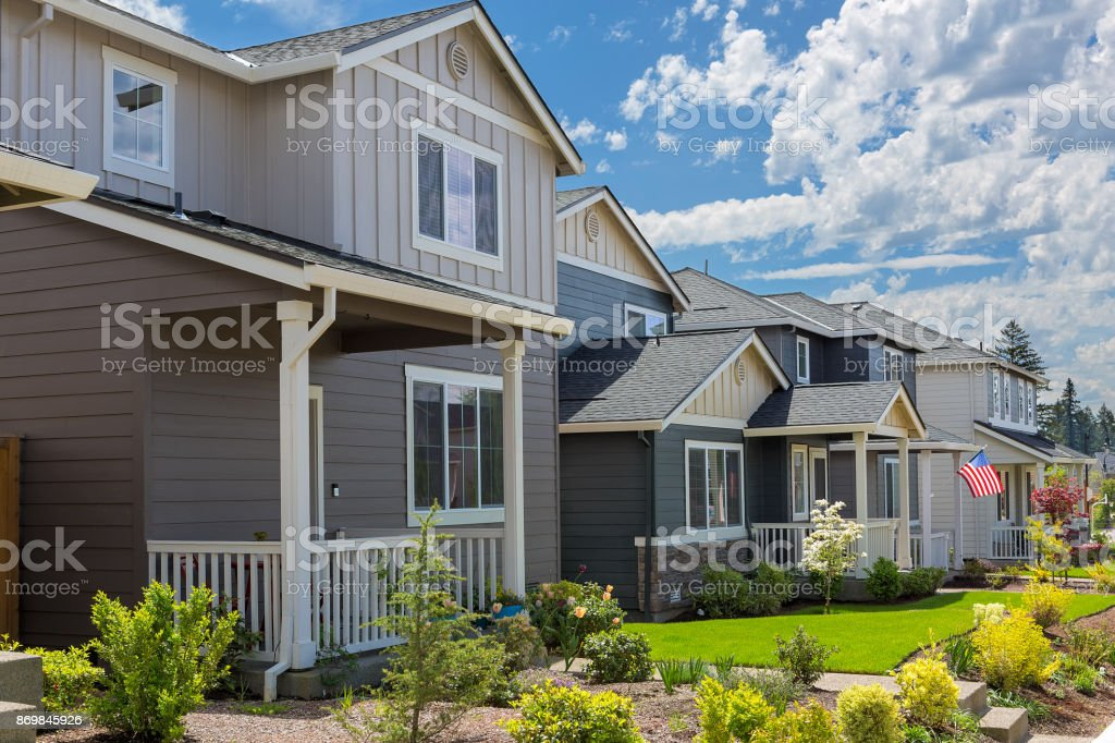 Tract homes with American Flag in new subdivision in North America suburb USA stock photo