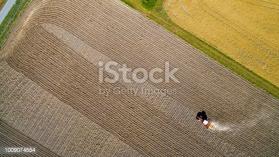 Tractor on a field thats look like art, harvesting, air photography