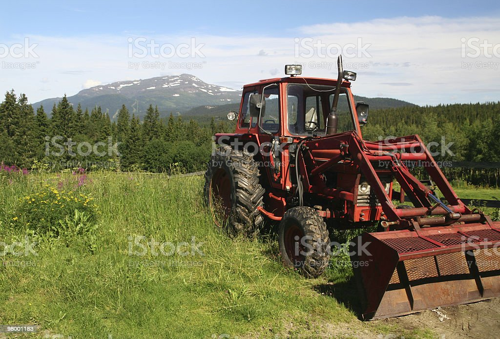 Tractor at meadow royalty free stockfoto