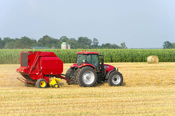 Tractor Baling Straw stock photo